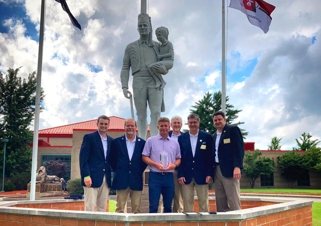 KDKA Sports Anchor Rich Walsh is flanked by Pittsburgh Syria Shrine members (left to right) Todd Green, Al Tedeschi, Randy Hobaugh, Illustrious Potentate Don Green and Scott Green.